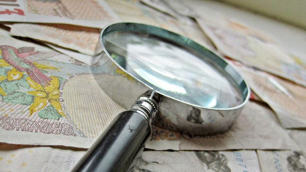 money pound sterling magnifying glass